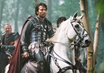 Pictured: Arthur (CLIVE OWEN) leads his men, Tristan (MADS MIKKELSEN, left), and Bors (RAY WINSTONE, back), in a scene from KING ARTHUR, directed by Antoine Fuqua and produced by Jerry Bruckheimer. FOR PRINT OUTLETS ONLY. NOT FOR INTERNET USE. Distributed by Buena Vista International. Permission is hereby granted to magazines and newspapers to reproduce this picture on condition that it is accompanied by (c) TOUCHSTONE PICTURES & JERRY BRUCKHEIMER FILMS, INC.